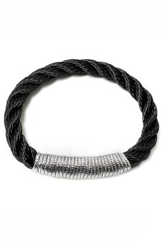 Bare and basic elegance. Without hardware, The Scarborough attracts a true rope enthusiast. The bangle's flexibility invites easy stacking with other pieces. Low-maintenance to the core, it goes seamlessly from one day's look to the next. Includes authentic The Ropes of Maine charm. 7mm Black Twisted Rope Metallic Silver.    Small - 6 to 6.5 inch wrist Medium - 7 to 7.5 inch wrist   Ropes Scarborough Bracelet  by THE ROPES OF MAINE. Accessories - Jewelry - Bracelets Minnesota