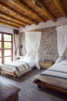 Such a pretty room. I love the wood beams and the walls
