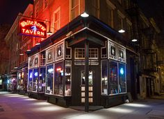 A Tour of New York City's Illuminated Storefronts at Night