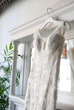 Custom Modern Trousseau Gown Style: Lauren Lace: Ainsley (ivory) Lining: Latte Charmeuse {Photo: Lark Photography}