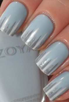 We love this subtle nod to winter weather, especially how the silver pops against the ice blue. The thin streaks of different shades of gray look like dangling icicles — a great twist to the popular gradient manicure. Click for more winter inspired manis. Nail Design, Nail Art, Nail Salon, Irvine, Newport Beach