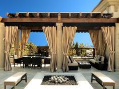 columns amidst covered patio as well fire balls including fire pit as well metal railing amidst outdoor curtains as well outdoor cushions alongside outdoor drapes as well patio furniture including pergola Outdoor Drapes, Gazebo Curtains, Modern Pergola, Patio Design, Outdoor Curtains For Patio, Outdoor Design