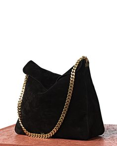 celine- black purse with gold chain detail- accessories.