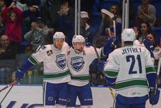 Tina Russell / Observer-Dispatch Utica Comets players crowd around Brandon DeFazio to congratulate him after scoring his first goal against the Lake Erie Monsters at the Utica Memorial Auditorium Saturday, Dec. 27, 2014. DeFazio earned a natural hat trick. Read more: http://www.uticaod.com/photogallery/NY/20141227/PHOTOGALLERY/122709999/PH/116_169_337_629_1640_1641_1651#ixzz3ND5j5oar