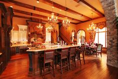 love the different colors of wood and how well they work together.  Beams and stone accents, I like it