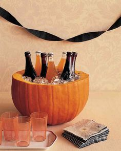 19 DIY clever Halloween party decorating tips you won't want to miss. We love #4 - a pumpkin cooler for your beverages.