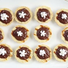 Chocolate Hazelnut Tartlets - Use up your Nutella the yummy and adorable way by baking bite-sized tarts.