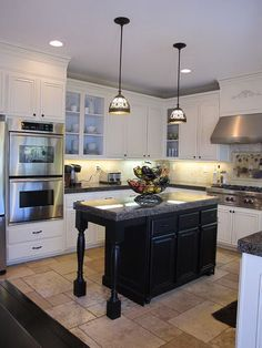 I pinned this just for the island shape. I think you could make your island bigger - I love the idea of the extended countertop with the legs of the island