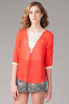 "Show+off+your+sweet+side+wearing+the+Clearmont+Crochet+Blouse.++This+feminine+red+top+features+a+delicate+crochet+cutout+along+the+neckline+&+sleeves.+Wear+with+a+pair+of+printed+shorts+&+wedges+for+a+cool+spring+look.+++<br><br>++  -	25""+length+<br>  -	32""+chest<br>  -	Measured+from+a+size+small<br><br>  -	100%+Polyester+<br>  -	Machine+Wash+<br>  -	Made+in+U.S.A.+<br>"
