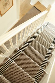 Roger Oates Stair runner creating a stunning design with muted colours - suitable for any stairscase. Located at The Silkroaduk.co.uk