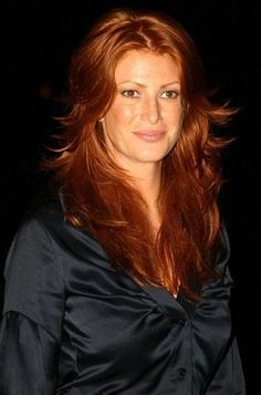 """Angie EverharT was reportedly Glamour magazine's first red-haired cover girl. She has described her color as """"a shiny copper penny in the light with an old copper penny mixed in."""""""