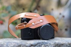 I completely love this DSLR camera strap | $35 Etsy | Personalized leather camera strap hand stitched. Tan color vegetable tanned.