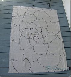 inexpensive outdoor diy painted drop cloth rug  i'm painting a new rug for the living room. :)  on canvas. :)