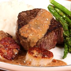Steak and Scallops with Champagne-Butter Sauce: Just as satisfying as it looks. Steak And Scallops With Champagne-Butter Sauce -Tasty - Food Videos And Recipes - Steak and Scallops with Champagne-Butter Sauce: Just as satisfying as it looks. Meat Recipes, Seafood Recipes, Dinner Recipes, Cooking Recipes, Healthy Recipes, Healthy Dinners, Healthy Baking, Pizza Recipes, Lunch Recipes