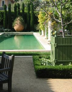 rectangular pool Italian cypress over scale planter gravel all the components of my kind of garden