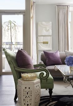 garden stools--good idea for end tables from: Ritz-Carlton Showcase Apartment by Samantha Todhunter - Traditional Home
