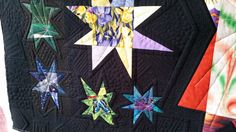 Starz quilt made by Sue P.  Longarmed by Le Ann Weaver of Persimmon quilts.