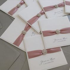 Dusky pink, white and grey wedding invitation