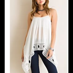 Brand new top Crinkle rayon handkerchief flare tank top featuring crochet lace on hem. Unadjustable straps. Non-sheer. Woven. Lightweight.  100%RAYON ENTRO Tops Tees - Short Sleeve