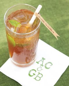 Glasses of sweet tea with banner-bearing straws greet guests at the ceremony.Flag straws, Aardvark Paper Straws.Cocktail napkins, art by the Paper Moon Project; printed by foryourparty.com.
