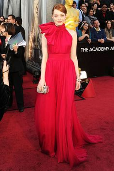 The 84th Annual Academy Awards  Emma Stone, in Giambattista Valli Haute Couture with a Louis Vuitton clutch and jewels.