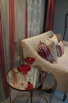 Romo window display. A calm and elegant mix of soft greys and raspberry pinks in Romo's Chelsea Harbour showroom - See more at: http://www.wesley-barrell.co.uk/what-s-on/2014/september/decorex_14#sthash.EBOvdSop.dpuf
