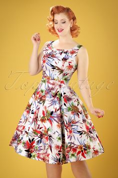 Shine brighter than the sun in this50s Lily Floral Swing Dress! Another Hearts & Roses stunner; this beauty is covered with the most stunning colourful flowers and has conquered our hearts again! The high round neckline with subtle pleats, elegant bow and full swing style make her a vintage fairy tale coming true. Made from a firm yet supple white cotton blend with a light stretch that's a joy to wear. Lovely Lily is vintage romance at its best!  Swing style ...