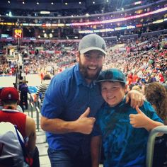 Shay and his baby boy Sontard, at a basketball game! thumbs up for father-son time!