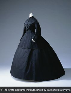 1865, America - Jacket, Skirt (black wool felt jacket with jet buttons at front opening; black silk taffeta and jet at pockets; black braid at front opening, cuffs and hem; black silk faille skirt) Reference: KCI Digital Archives