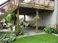 I love the idea of leaving some soil against the house underneath the upper deck so I can plant hostas in the shade!! The hammock's nice, too. :)
