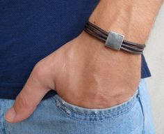 "Men's Bracelet - Men's Geometric Bracelet - Men's Brown Bracelet - Men's Leather Bracelet - Men's Jewelry - Bracelets For Men - Gift for Him  Looking for a gift for your man? You've found the perfect item for this!   The simple and beautiful bracelet combines 3 dark brown leather bands with a silver plated square element.  The bracelet clasp is easy to use and safe.   Lengh: 7.6"" (19.5 cm) + 2"" (5 cm) extension chain. $32"