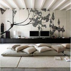Une photo d'une jolie décoration intérieure moderne avec des coussins de sols couleur caramel et gris
