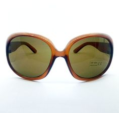 Caramel brown oval shaped sunglasses featuring UVA/UVB 400 protection for round, oval, long or square faces.