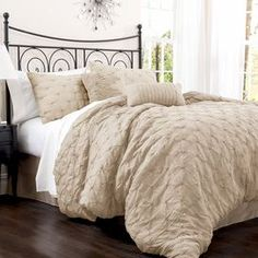 """Cotton-blend comforter set with an embroidered diamond motif.    Product: Queen: 1 Comforter, 1 bedskirt and 2 standard shamsKing: 1 Comforter, 1 bedskirt and 2 king shamsConstruction Material: Cotton-blendColor: TaupeFeatures: Embroidered diamond motifDimensions: Standard Sham: 20"""" x 26"""" eachKing Sham: 20"""" x 36"""" eachQueen Comforter: 92"""" x 96""""King Comforter: 96"""" x 110""""Note: Accent pillows not included. Shams do not include inserts.Cleaning and Care: Dry clean"""