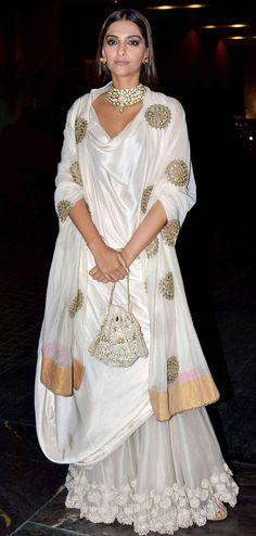 Sonam Kapoor shines away in a gold and cream lehenga fusion (Photo: Yogen Shah)