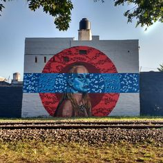 """The stunning art work in Córdoba, Argentina by the talented artist Lu Yorlano with her colleague El Lolo. They have been painting murals together with their collective project called """"Sapo Rojo"""", but until now they haven't shared a wall to paint on! And it looks amazing in a word! #Streetart #Mural #Artwork #LuYorlano #ElLolo #Córdoba #Argentina #Allpublicart"""