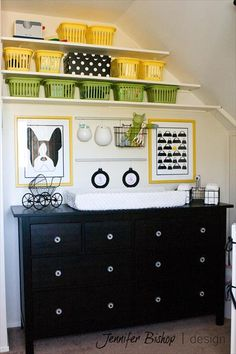 I like the yellow and green bins as a way to organize baby items on the built-in shelves. www.thebump.com