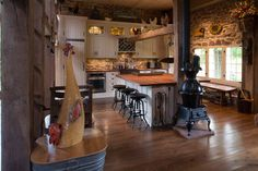 The Barn - Farmhouse - Kitchen - New York - Digital Architecture Inc *** My OH MY.pot belly stove, roosters, wood countertops, custom stone work, the cabinets are perfect.really gorgeous! Traditional Kitchen Interior, Interior Design Kitchen, Country Kitchen Designs, Country Kitchens, Farmhouse Kitchens, Dream Kitchens, Kitchen New York, Stone Interior, Diy Kitchen Decor