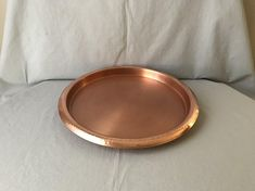 """Copper over stainless steel round serving - bar tray with hammered rim. Inside diameter 12"""" , bottom diameter 11 3/4"""" , diameter including rim 14"""" . This handsome copper bar tray is in excellent vintage condition. Convo me for international shipping and Ill add your country to the"""