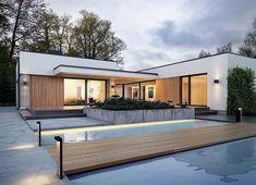 Projekt domu Agos 181,15 m² - koszt budowy - EXTRADOM Spanish Design, Dream House Plans, Garage Doors, Patio, Mansions, House Styles, Outdoor Decor, Houses, Home Decor