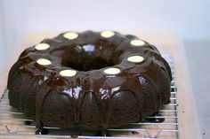 Super Yummy Cake!  For 1 bundt cake and 1 small personal cake: warm 3 sticks butter, 1.5 cups milk stout, 98 grams cocoa powder on stove. Whisk 3 large eggs and 1 cup sour cream and then blend all together. MIx the following and then add slowly to above mixture: 345 grams flour, 500 grams sugar, 2.25 teaspoons baking soda and 1.12 teaspoons salt. For ganache: 255 grams semisweet chocolate, 135 grams heavy cream, 1 teaspoon and smidge more of instant espresso.