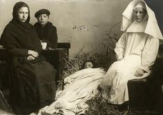 Refugees. A French woman and her children (her daughter is ill) are taken care of by a Dutch nun. Holland / Netherlands, 1918.