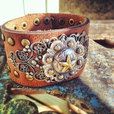 Up-cycled Leather belt cuff with western conch