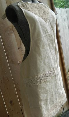 Repurposed table cloth apron with vintage tatting at neck line, lace on pocket and hem line.  DoodleBerry Designs by Kathy $25