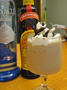 Mudslide Milkshake...In a blender, combine: 2 scoops of chocolate ice-cream, 1 shot of whipped cream vodka, 1 shot of coffee flavored liqueur, 2-3 coffee cubes, crushed.   Milk to your desired consistency