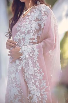 This pure organza shirt has an intricately handworked neckline and embroidered borders on shirt and sleeves. It is further embellished with sheesha spray and can be paired with the beautiful complimenting ourhnee. Pakistani Dresses Casual, Indian Fashion Dresses, Pakistani Bridal Dresses, Pakistani Dress Design, Indian Designer Outfits, Designer Dresses, Pakistani Couture, Pakistani Engagement Dresses, Pakistani Clothing
