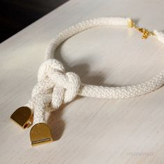 Eco - friendly fashion urban necklace. Natural colored cotton rope, big knot and gold colored elements. Ready to ship