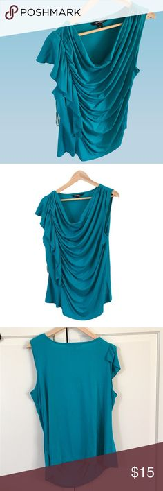 "Ruched Turquoise t-shirt - super soft A turquoise t-shirt ruched to the right. Ruffle-like design. Super soft material. Hits just below the hip. Measures approx 22"" under arm. Back of shirt measures approx 25.5""  and front 37.5"" from top at shoulder seam to bottom (hi low style). EUC. Size L. Smoke/pet free environment. sharagano Tops Tees - Short Sleeve"