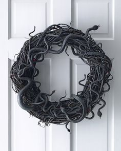 Pin for Later: 60+ of the Most Spooktacular Halloween DIYs Wriggling Snake Wreath Greet your guests with a scare with this slithering snake wreath.  Source: Martha Stewart