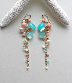 Made to order. Please see shop announcement or the policies page for current production times. Say hello to summer with these playful, bright, and swingy new earrings! Minty-cool aqua and warm peach coral bring to mind calm waves lapping at your feet as you bask in the afternoon